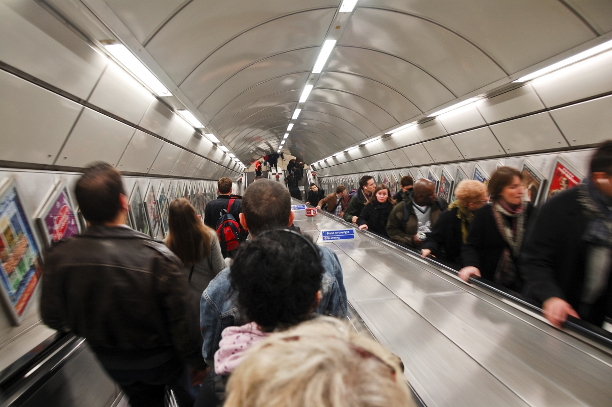 tube london underground escalator commuters